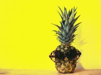le-phare-association-green-pineapple-fruit-with-brown-framed-sunglasses-beside-1161547